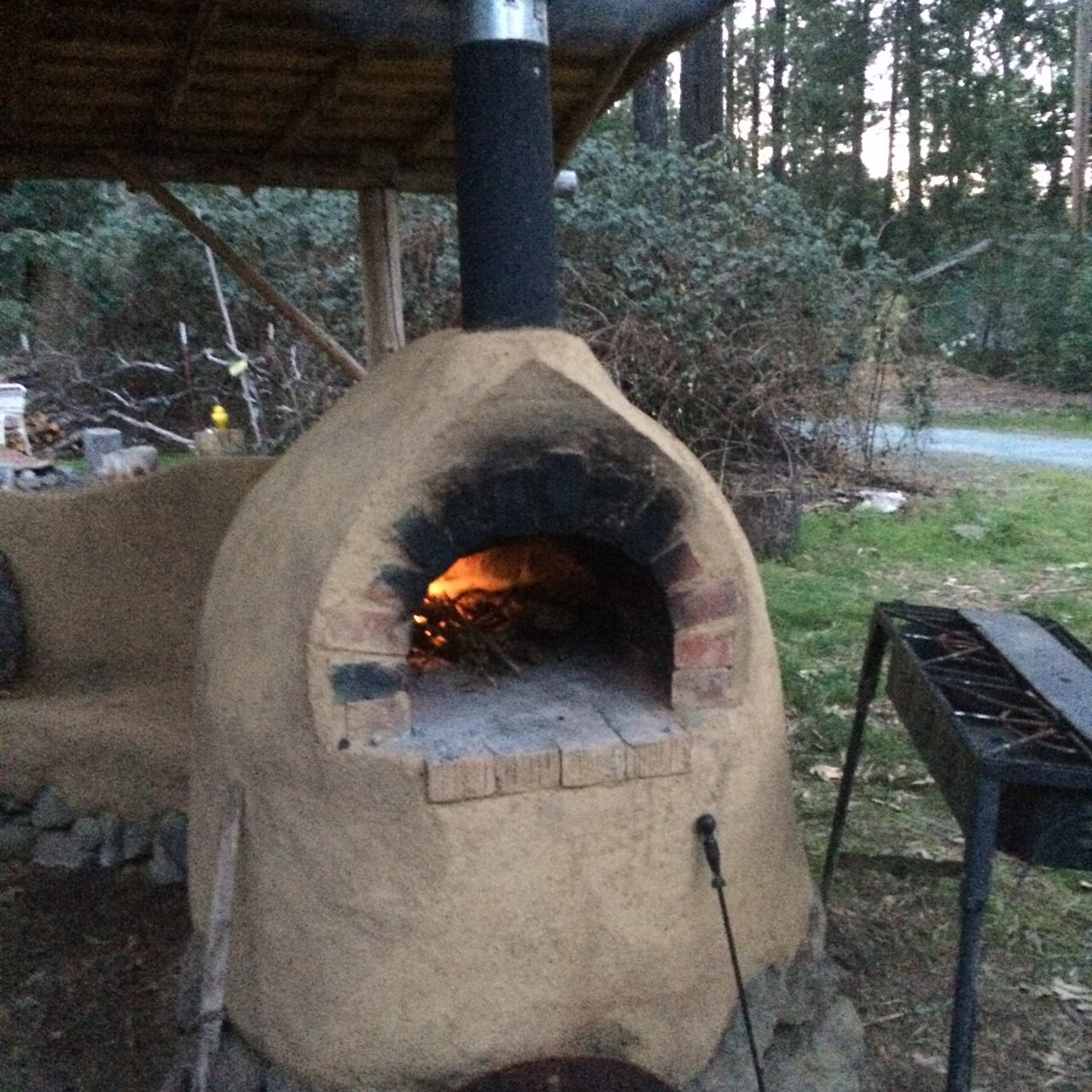 The cob oven at Laytonville Ecovillage is a gathering place— come join us as an intern or work-trader!
