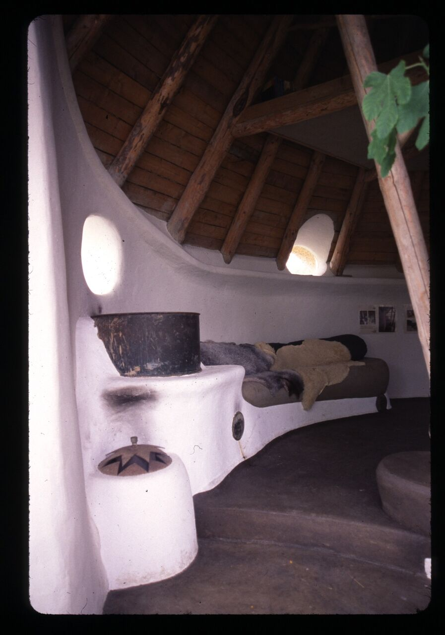 A rocket mass heater in a cob cottage in Denmark by Flemming Abrahamsson. Photo: Catherine Wanek